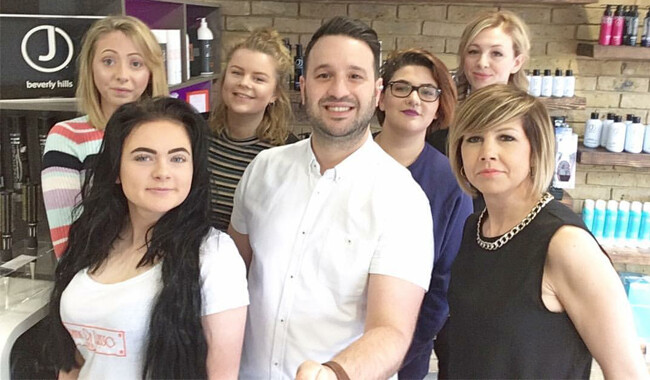 Hairdressing salon owner Frank Di Lusso with his hairdressing assistants.