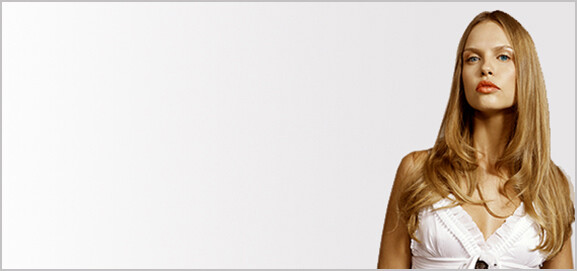 Female hair model with long dark blonde hair extensions.